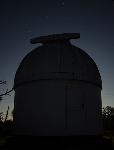 Supermoon backlighting the observatory dome